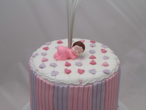 New baby cake with bed of hearts
