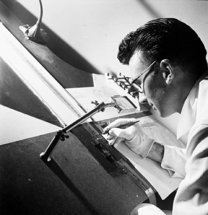 Norman McLaren, of the animation department, National Film Board of Canada, drawing directly on film in 1944.