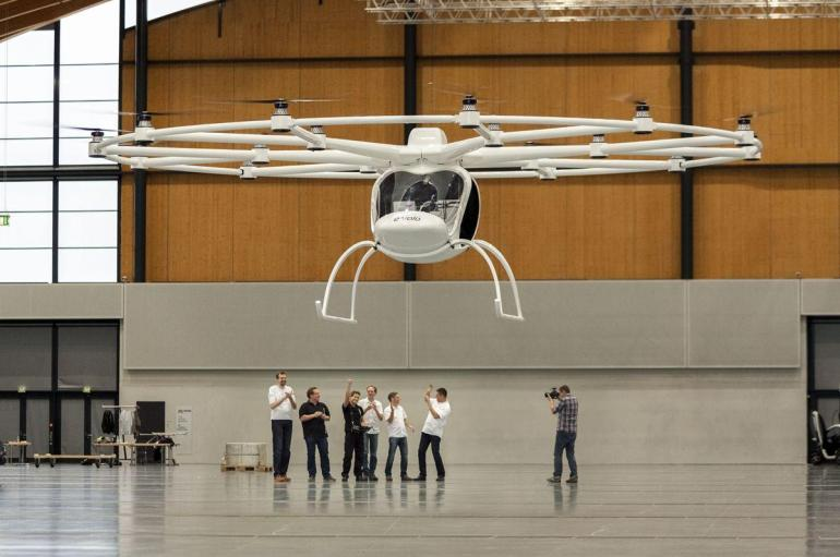 A cheer goes up from the Evolo company crowd as the Volocopter 200 makes its maiden public test flight.