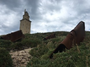 There are three giant heads that guard the Tower of Hercules