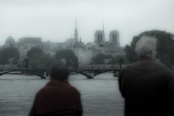 """The Pont des Arts, cleared of """"love locks"""", appears in the middle ground. A pedestrian bridge, it was closed with the rising river. I first tweaked this image to bring in some contrast and color only to then change my mind — I decided to accentuate the grey."""