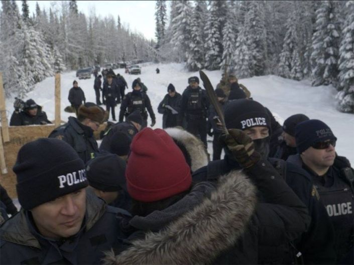 Fourteen people arrested after RCMP break down anti-pipeline checkpoint