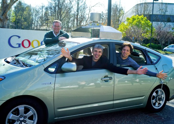 Eric Schmidt, Larry Page & Sergey Brin (L-R) in one of the earlier Toyota Priuses with their self-driving technology