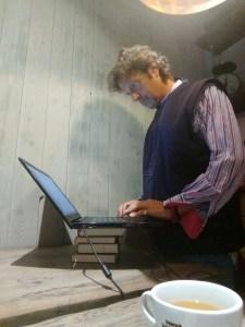 Nick Parker- The Cancer JourneyMan - standing at desk