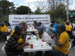 Glades residents gather for a community meal prior to the meeting