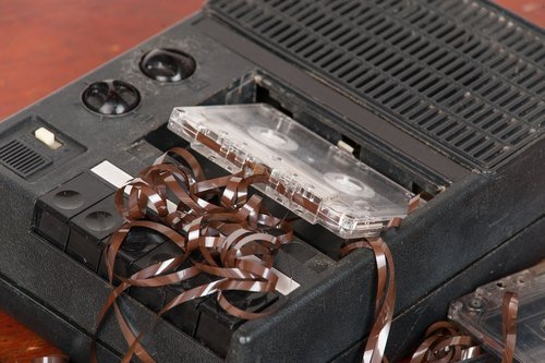 a tape recorder with the magnetic tape unravelled