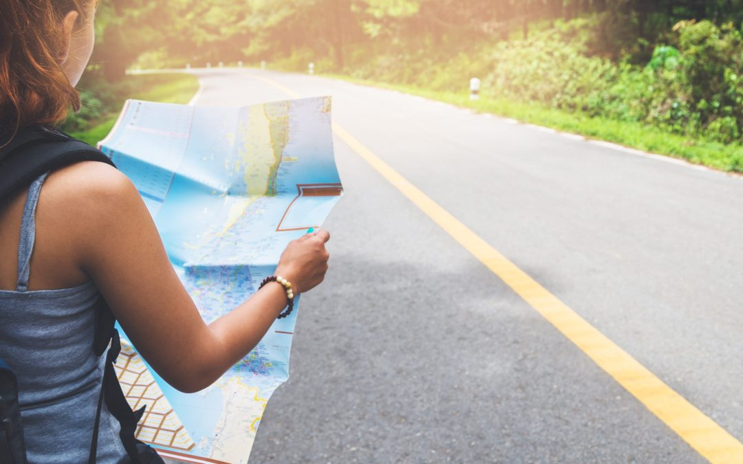 young woman looking at the map of her life with a road before her