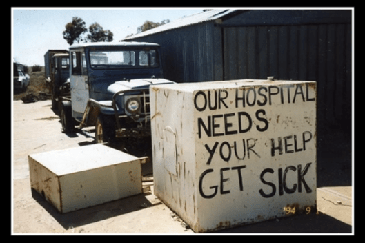 sign saying our hospital needs your help get sick