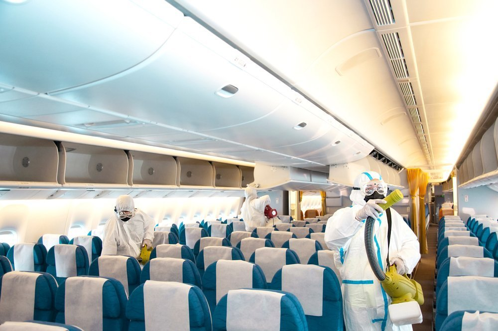 Covid-19 disease prevention. Aircraft interior cabin deep cleaning for coronavirus