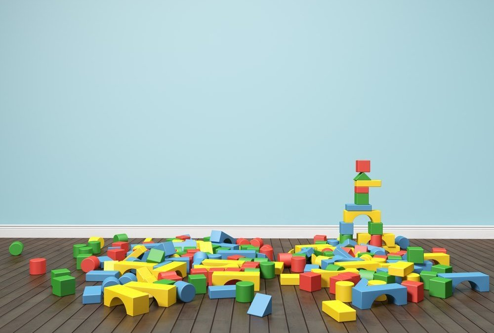 tower of building blocks, concept of balancing competing needs of caring for a child, elderly aunt, and self while working full-time and being a good husband