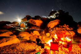 Campfire and climbers at Joshua Tree National Park, California, USA