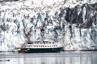 An Adventure Cruise Ship Lays Anchored Next To Lamplugh Glacier,