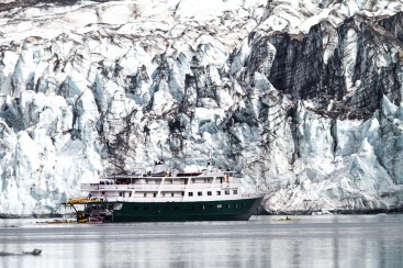 An Adventure Cruise Ship Lays Anchored Next To Lamplugh Glacier,