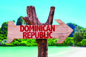 Dominican Republic wooden sign with beach background