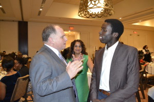 Lawyer Rocco Galati, left, and anti-carding activist Desmond Cole discuss the province's plans to end carding across Ontario. Gerald V. Paul photo.