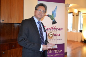 Tyrone Tang, CEO of Caribbean Airlines, with CTO award for outstanding service. Gerald V. Paul photo.