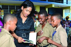 Lisa Hanna with some of the Jamaican youth who are her focus. By Claudette de la Haye Caribbean Financial Network News