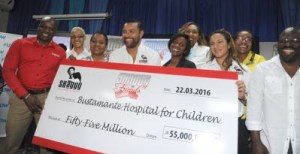 Shaggy, fourth from left, with the cheque for Bustamante Hospital for Children.