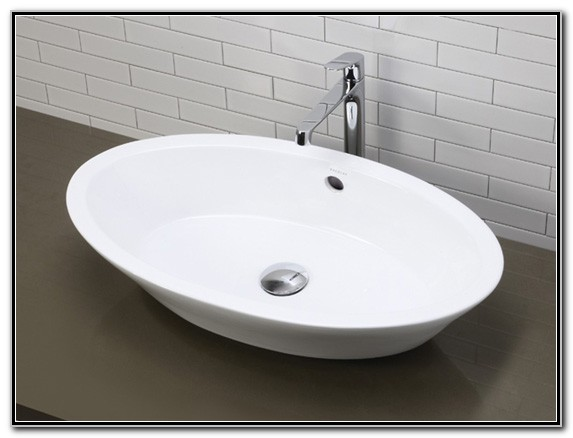 White Vessel Sink With Overflow