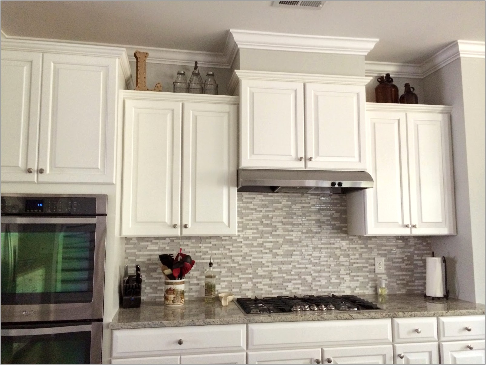 Decorating Above Staggered Kitchen Cabinets