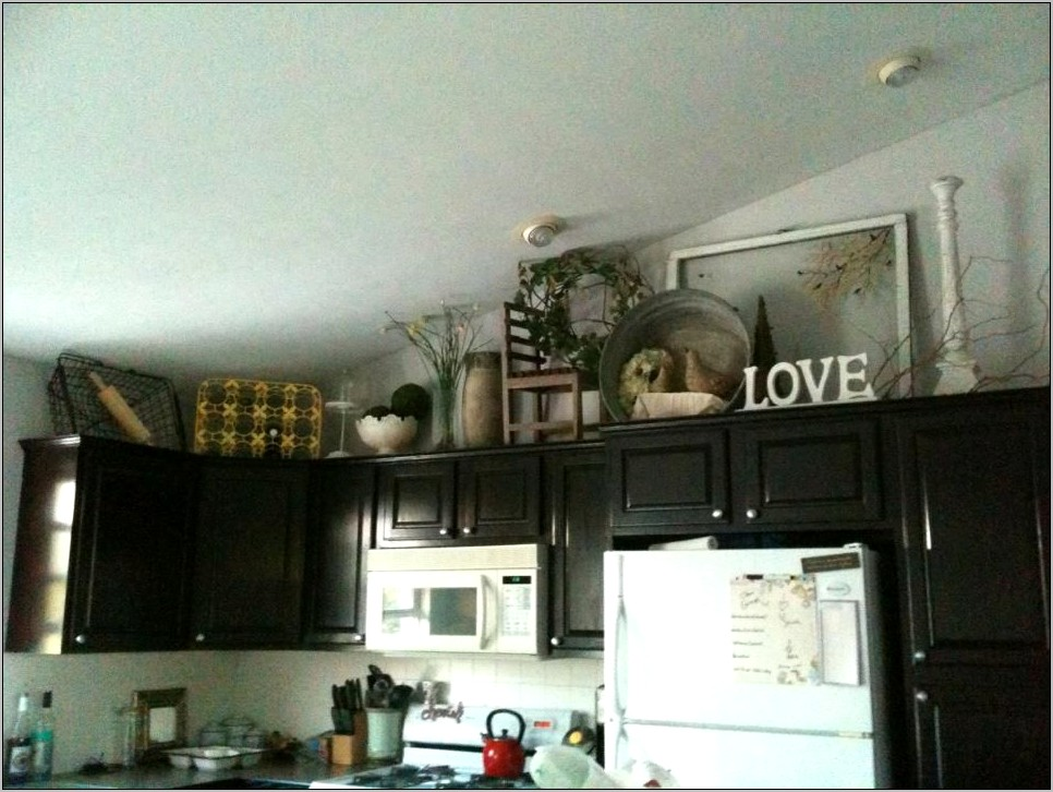 Decorating With Metal Signs Above Kitchen Cabinets