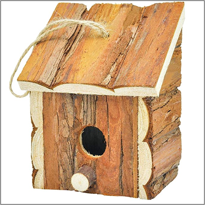 Decorative Birdhouse Hung From Kitchen Ceiling