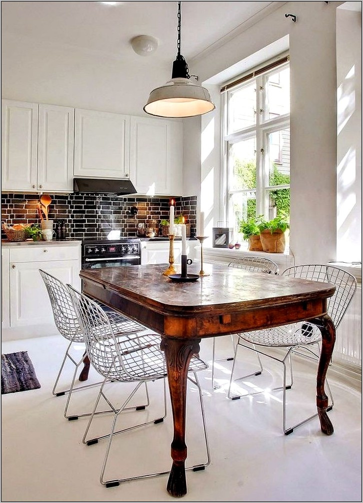 Interior Decorators Kitchen With Iron Table Chairs