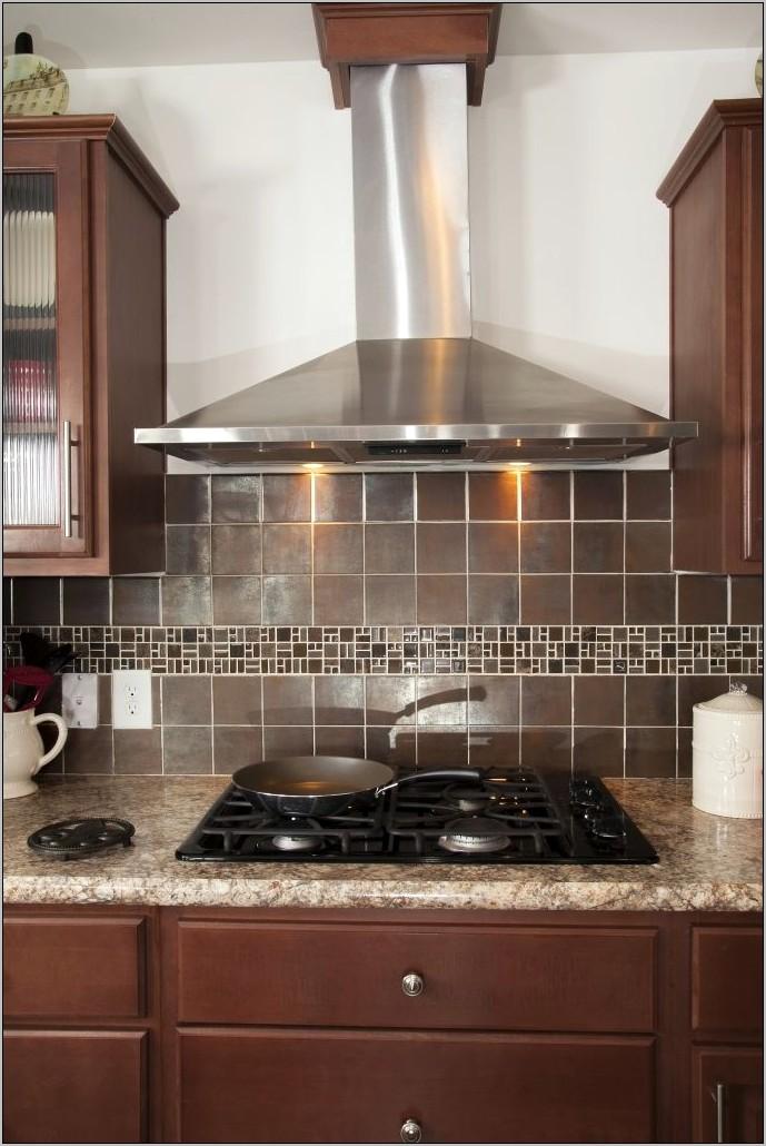 Kitchen With Decorative Range Hood
