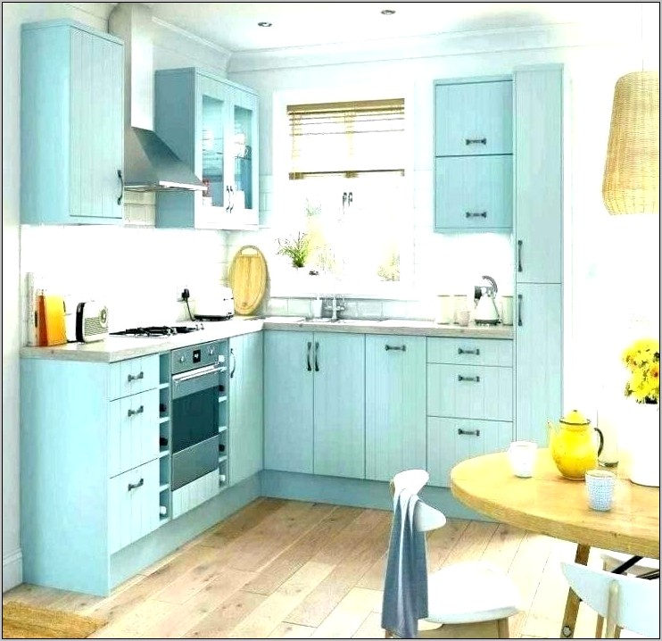 Teal Decor In White And Gray Kitchen