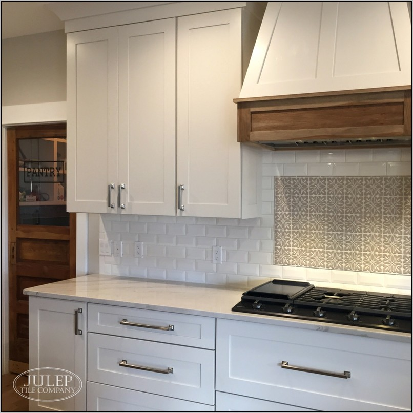 White Farmhouse Kitchen With Decorative Backsplash