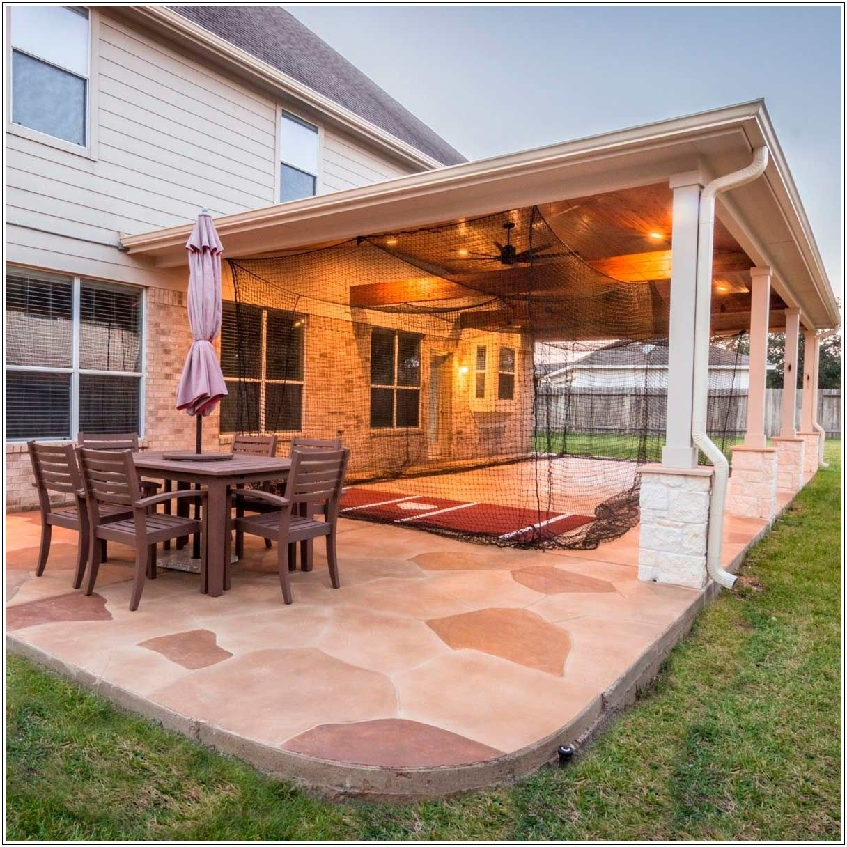 Backyard Stamped Concrete Patio With Pergola