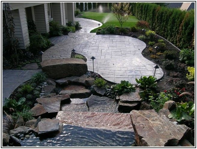 Landscaped Backyard Stamped Concrete Patio