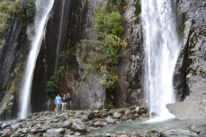 Me with Blake and Kevin under two waterfalls near Franz Josef Glacier