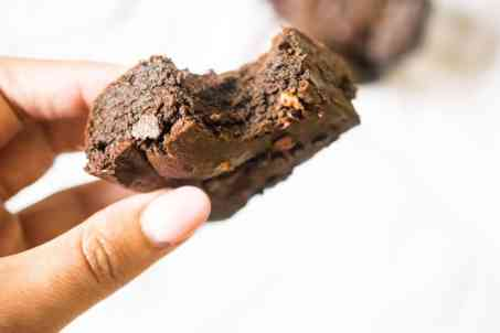 woman's hand holding brownie