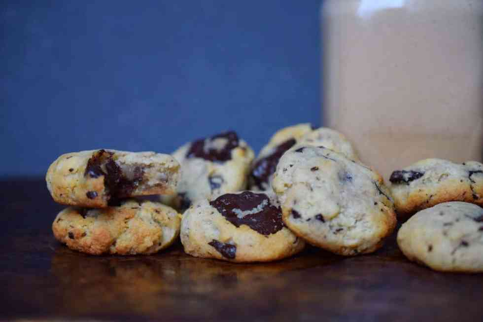 pile of chocolate chip cookies on a table