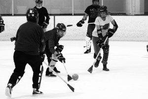 Students risk life and limb to play intramural broomball. Photo by Morgan Bak