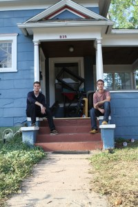 From left: Jayson Post and Gavin Nachbar, both seniors, pose on the porch of their home at 318 Cache La Poudre St. Nachbar confronted a burglar at their home early monday morning. Nachbar and POst are two of give roommates who live at the home. Photo by Jesse Paul.