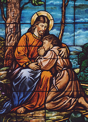 Jesus embraces a sinner in stained glass at St. John the Baptist in New Brighton. Photo by Father Michael Van Sloun