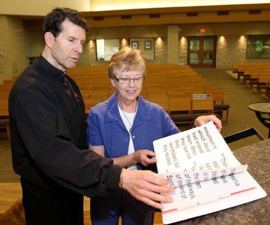 Fr. Bob White with parishioner Mary Bishop