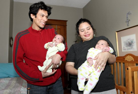 From left, Casa Guadalupana residents Elder and Karen hold their newborn twins, Helder, left, and Krystal, who were born on Nov. 8. The couple is from Nicaragua. Dave Hrbacek / The Catholic Spirit
