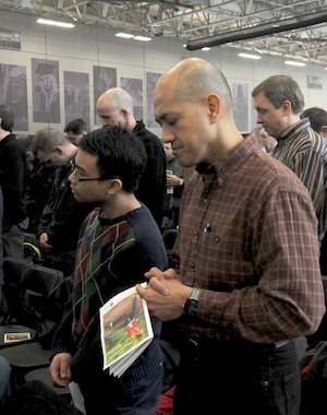 Leo Avenido and his son Ryan, 14, members of St. Joseph in Rosemount prayed during the conference, which was  sponsored by the archdiocesan Office of Marriage, Family and Life.