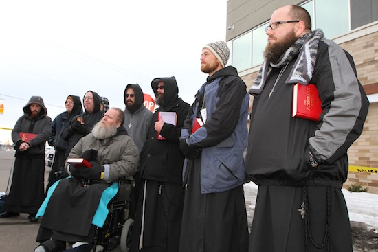 Members of the Franciscan Brothers of Peace listen to a meditation. At right is Brother Conrad Richardson. Seated is Brother Joseph Katzmarek.