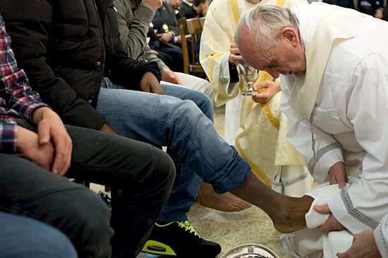 Pope Francis washes the foot of a prison inmate during the Holy Thursday Mass of the Lord's Supper at Rome's Casal del Marmo prison for minors March 28. Pope Francis washed the feet of 12 young people of different nationalities and faiths, including at least two Muslims and two women, who are housed at the juvenile detention facility.