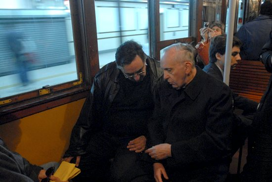 Argentine Cardinal Jorge Mario Bergoglio, right, now Pope Francis, is pictured traveling by subway in Buenos Aires in 2008. CNS photo / Diego Fernandez Otero, Clarin handout via Reuters