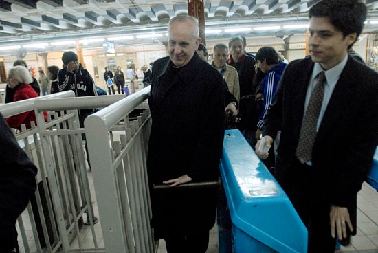 Argentine Cardinal Jorge Mario Bergoglio, now Pope Francis, is pictured walking through a subway turnstile in Buenos Aires in 2008 CNS photo / Diego Fernandez Otero, Clarin handout via Reuters