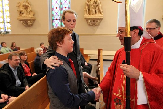 Matthew Brown greets Bishop Lee Piché after being confirmed during a special Mass April 22 at St. Mary in Stillwater. His scheduled confirmation was moved up to accommodate the failing health of his sponsor, Zach Sobiech, center, who was diagnosed with osteosarcoma, a rare form of bone cancer, in November 2009. The disease has advanced and spread to the point that he is not expected to overcome the tumors that now fill his body. Watch TheCatholicSpirit.com for an upcoming story about the journey of faith and courage for Zach and his family. Dave Hrbacek / The Catholic Spirit