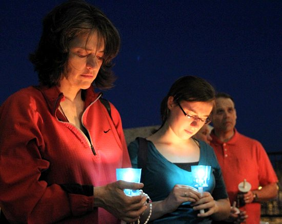From left, Barbara Sherf and her daughter Lauren of Nativity of Our Lord in St. Paul and St. Joseph in West St. Paul participate in a candlelight vigil on the steps of the Cathedral of St. Paul on May 14, the day Gov. Mark Dayton signed into law a bill allowing same-sex couples to marry. The vigil was organized by Jenni Maas of Nativity, and Father Thomas McDonough read Scriptures and offered reflections. Dave Hrbacek / The Catholic Spirit
