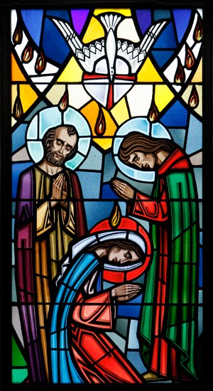 A scene from Pentecost is depicted in this stained-glass window. CNS photo / Gregory A. Shemitz, Long Island Catholic
