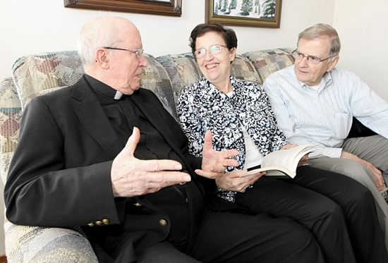 Beth, center, and Roger Maulik, right, talk with Beth's brother, Father James Fangman, left, a retired priest from the Diocese of Sioux City, Iowa, in his room at Carondelet Village in St. Paul. Dave Hrbacek / The Catholic Spirit