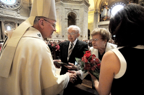Archbishop John Nienstedt and Jean Stolpestad, right, director of the Archdiocesan Office of Marriage, Family and Life, presented a plaque and flowers to Ambrose and Leona Yantes, members of St. Peter in Delano, who celebrated their 75th anniversary this year.